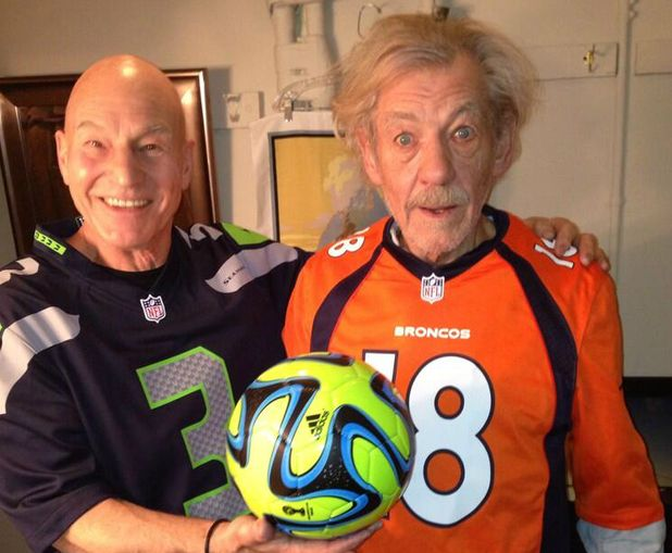 I'm sure there'll be a blue & white stripe shirt under that Seahawks top! - Patrick Stewart and Sir Ian McKellen pose in 'football' jerseys with a 'football' ahead of the Superbowl.