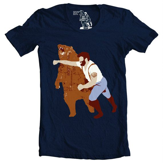 Many have speculated as to what the Haymaker T-shirt means. Paul Bunyon knocking out a bear on a shirt?
