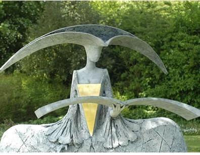 Garden sculpture with book.
