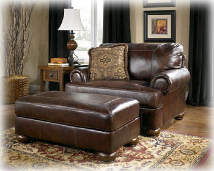 "The ""Axiom-Walnut"" leather upholstery collection features rich leather upholstery surrounding plush rolled arms and beautifully detailed box stitched seating and back cushions to flawlessly capture the sophistication and elegance of inviting traditional design.  ‪#‎TraditionalFurniture‬ ‪#‎AshleyFurniture‬"