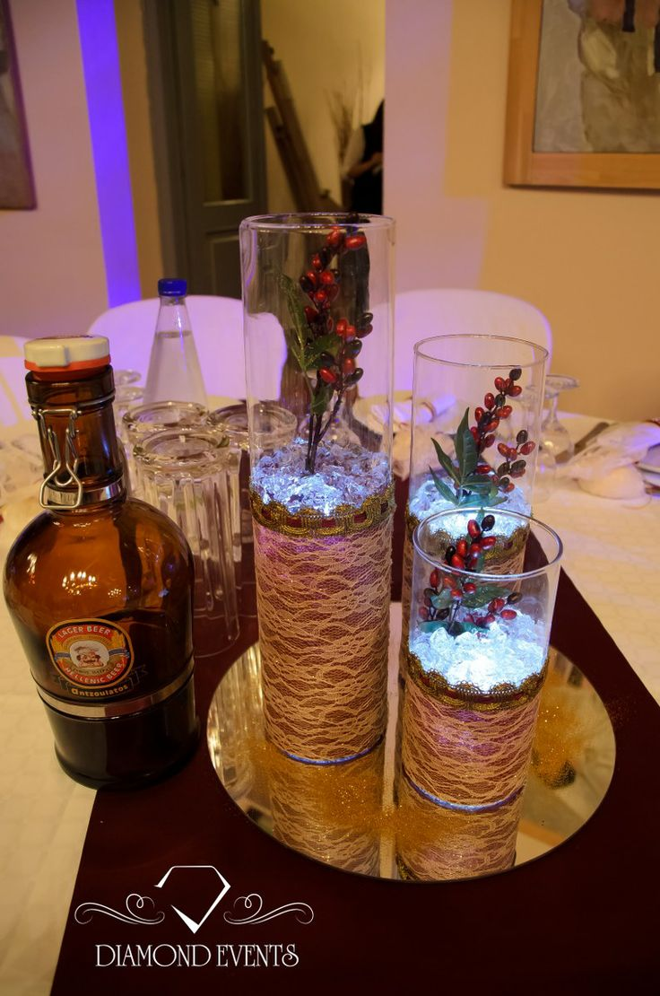 Christmas centerpiece with 3 cylinder vase with lace on a ...