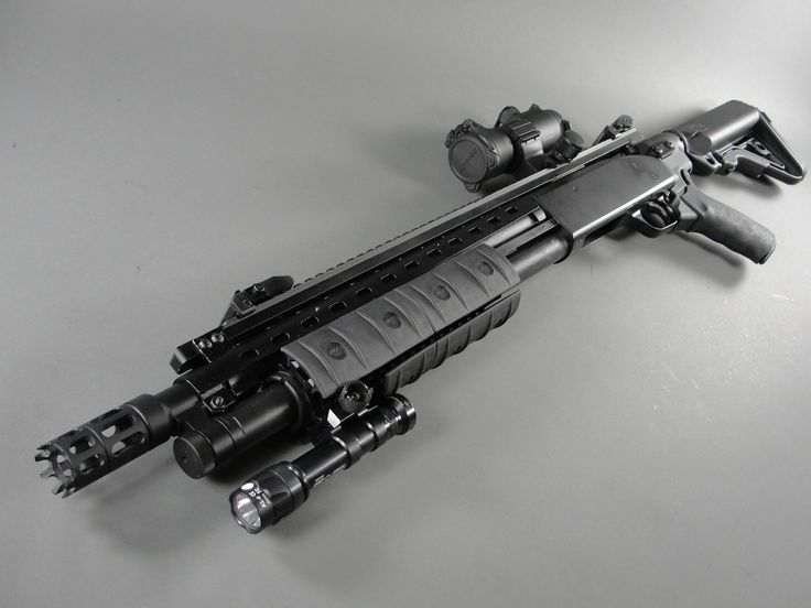 Tricked out Mossberg 500. If I had to settle for something other than a Remington 887 NitroMag Tactical or 870 Tactical, this is what I'd have to go with, but it would have to be decked out with tactical add ons.