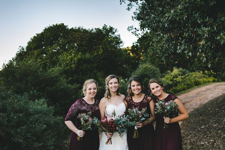Don't you just love these eucalyptus and protea bride and brides maid bouquets.
