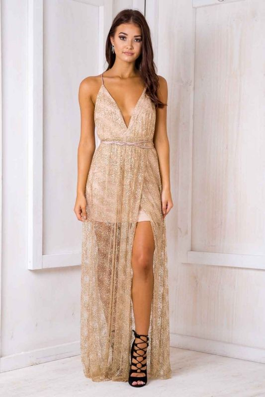 """STELLY MESH/SEQUIN MAXI DRESS The """"Laila dress"""" is a stunning dazzling dress perfect for that special occasion! Featuring a halter V-neckline with extra long straps, wrap around appearance, low elastic back and sheer hemline. Style it with heels and a nude clutch bag."""