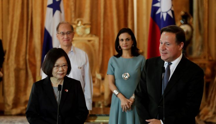 Taiwan's President Tsai Ing-wen (L) listens to her counterpart Panama's Juan Carlos Varela after a bilateral agreement during a meeting at the Presidential Palace in Panama City, Panama June 27, 2016. REUTERS/Carlos Jasso - RTX2IJKV