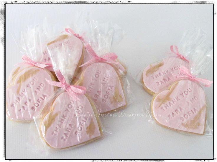 Pink and gold heart shaped thank you cookies.