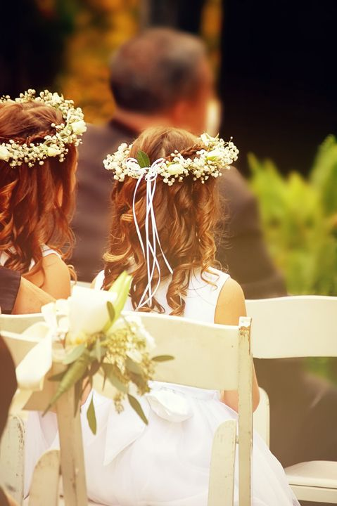 Baby's breath and cream roses make up these flower girl headpiece wreaths for a Renaissance inspired wedding. Music performed by Ben Sherman Classical Guitar.