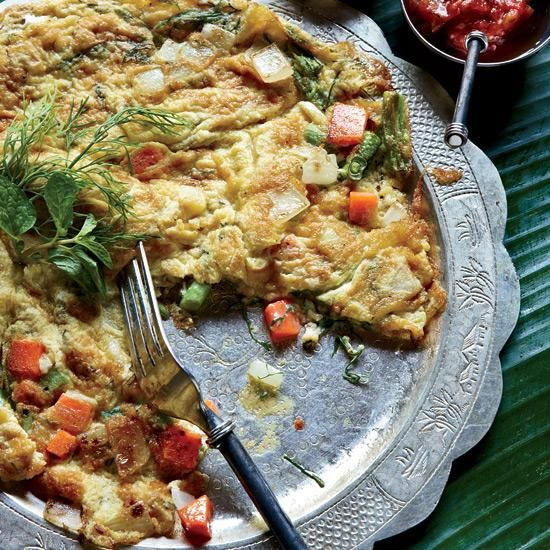 Lao Omelet with Dill, Scallion and Thai Chile | The dill, fish sauce and scallions in this round omelet may seem like an overly bold combination of flavors, but the result is surprisingly delicious. It's also adaptable: Eat it for breakfast or as a quick, light supper.