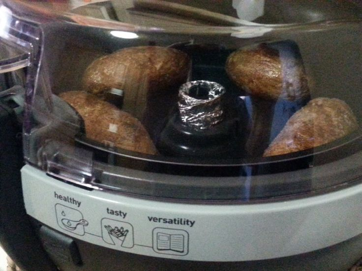 "Easy ""Actifry"" Baked Potatoes- Scrub and dry potatoes, prick w/ knife sev. times. Microwave 5 min then place in ""Actifry"" ( w/ NO paddle) I use a foil sleeve over the mechanism. Bake 15 min. Turn and bake another 15 min. till centers are tender ( about 35-40 min for large potatoes) Note: you can season the potatoes w/ oil and coarse salt before baking ?"