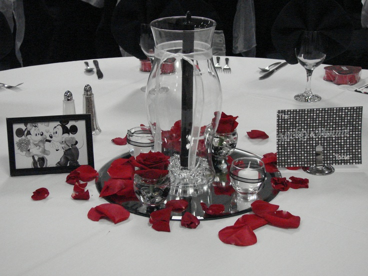 """Wedding reception centerpieces. Red and Black theme. The guest were assigned to their tables with a """"famous couple"""". This table was Mickey and Minnie mouse."""