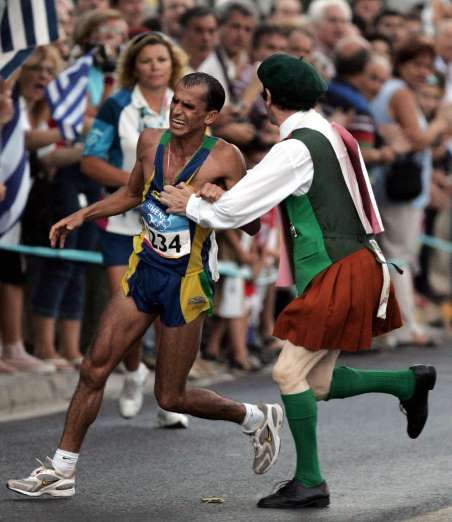 August 29,2004: MARATHONER ASSAULTED AT OLYMPICS  -   Brazilian distance runner Vanderlei de Lima is attacked by a spectator while running the marathon, the final event of the Summer Olympics in Athens, Greece.