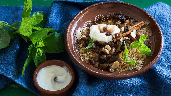 Sweet couscous seffa is a delicious and healthy dish that's enjoyed for breakfast and dessert in Morocco. The couscous is mixed with dried fruits, yoghurt and orange blossom. Listen to the audio recipe.