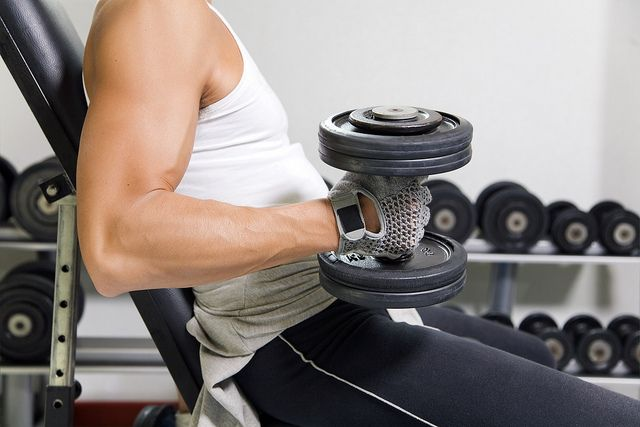 health club: guy in a gym doing weight lifting. Super! See This! http://all4betterlife.com