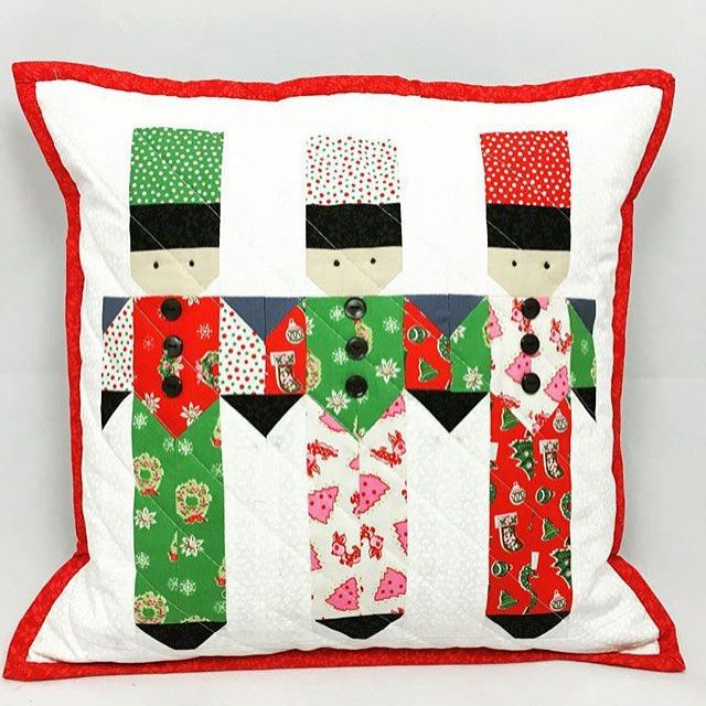 This darling pillow is a free pattern by and was made by