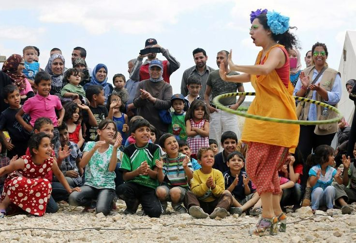 Over 50 million people were forced to flee their homes at the end of 2013. More than half of these were children, according to a United Nations report released to mark World Refugee Day on June 20. | These Pictures Of Clowns Making Refugee Children Laugh Are Truly Heartbreaking
