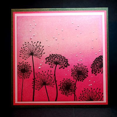 card with bright pink ombre background...white dots and black stamped dandilions...beautiful inking on this card!!!