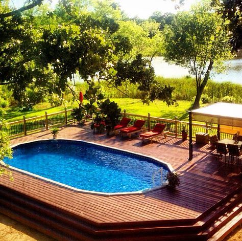 Above ground pool with deck looks amazing! More