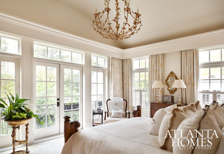 A cream-colored palette creates a soft, inviting space in the light-filled bedroom. // Atlanta, GA
