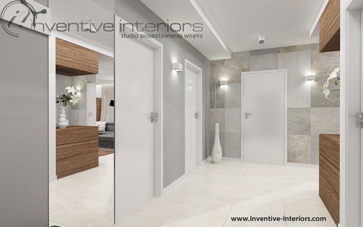 Projekt korytarza Inventive Interiors - przestronny korytarz z fornirem kamiennym na ścianie