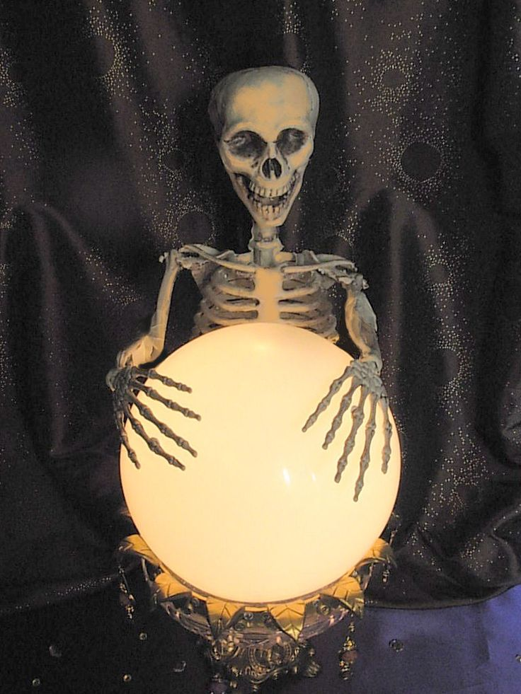 """If you're looking for lots of Halloween decorating ideas to replicate, this is the site for you. This was made from a light fixture ball and an old candy dish, with some other touches. """"Seeing Things: DIY Crystal Ball"""""""