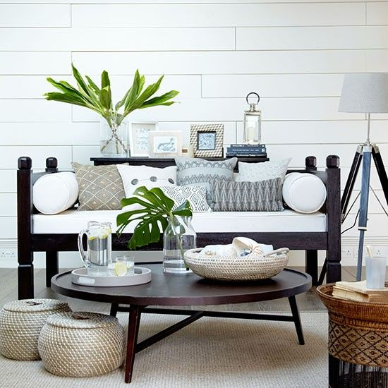 White Wall Stained Black Chair Brown Rug Round Coffee Table Stand Lamp Living Room