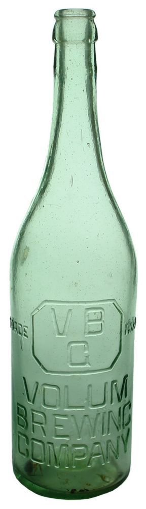 Embossing: Trade (VB / G in a bevelled rectangle) Mark / Volum / Brewing / Company // This bottle is not sold / & still remains the property / of the Volum Brewing Co. Ltd. Small punt to base. (Geelong, Victoria) Type: Beer Crown Seal /  Era: 1910s /  Variety: Champagne. Spun finished top. Aqua. 26 oz. /  Height: 310 mm /  Condition: Very Good. 7 x 7 mm part of a bubble is burst and has been filled with araldite which is yellowing. A little dull, some scuffs and scratches. Baby oil inside…
