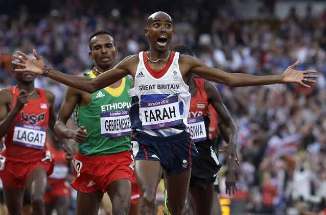 Day 15: Evening Session - Track & Field Slideshows | Britain's Mohamed Farah celebrates as he crosses the finish line to win the men's 5000-meter final.  (Photo: Anja Niedringhaus / Associated Press) #NBCOlympics