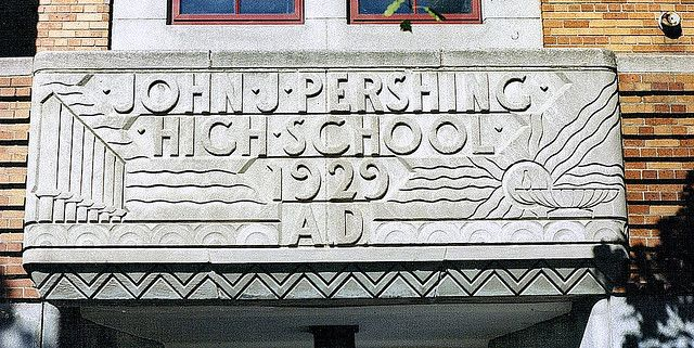 Entrance: Pershing High School--Detroit MI    Art Deco was the medium of expression for the entryway to this Detroit high school named for America's five-star general of World War I. Pershing is nearly identical to Denby High in terms of design. The building's architectural sculpture was done by Corrado Parducci.