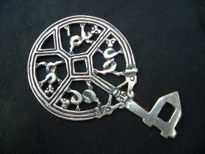 Silver key was a status symbol worn by Viking women. This particular design is a copy of the gripping beast style. 9th century from Scandinavia. Danish National Museum.