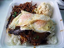 loco moco - white rice topped with hamburger patty with brown gravy and egg on top....  It's supposed to have been created at either Lincoln Grill or May's Fountain, two local eateries in Hilo in the 1940s.   Wikipedia, the free encyclopedia