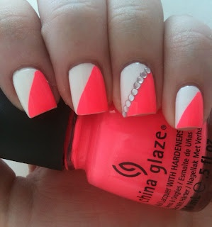 Neon Pink Orange Nails With White Diagonal And Rhinestone Accents