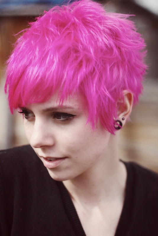 long pixie cut, bright pink with a bed head look. Good way to grow out ...