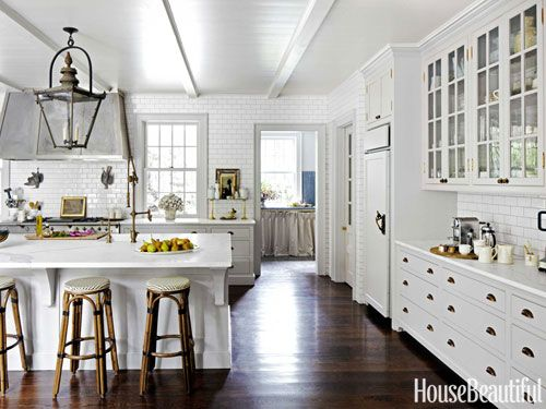 """Kitchen walls are sheathed in subway tiles """"like the French bakeries I love,"""" [designer Jeanette] Whitson says."""
