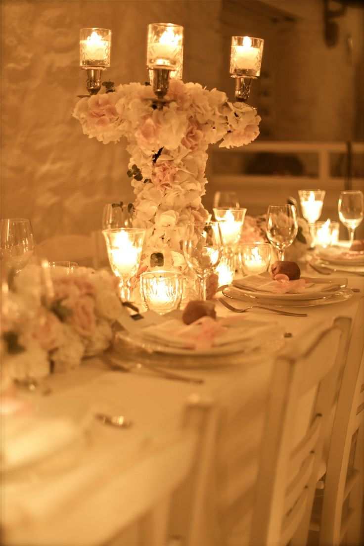 The decoration of the dinner table!Gorgeous candelabras, white candles and lots of flowers!