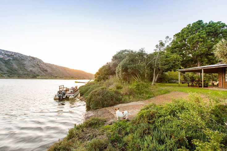 Ramshackled and relaxed, this converted boat shed is incredible as a rustic hideaway for two, where you can wake up to views of the river and cook or read to candlelight.
