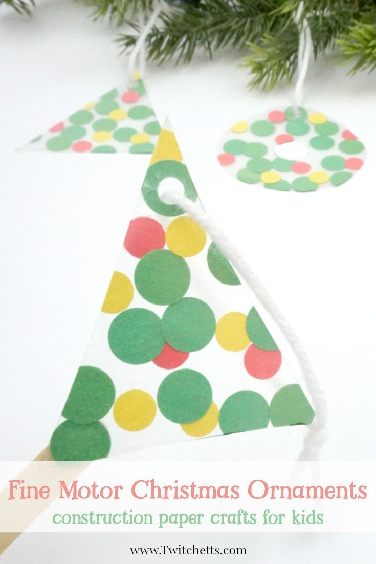 This fun fine motor Christmas ornament uses inexpensive construction paper to create a suncatcher that can be given as a gift or hung on your tree.  #finemotorchristmasornament #finemotoractivities #christmasornaments #christmascraftsforkids #christmasactivitiesforkids #craftsforkids #kidsactivities #twitchetts