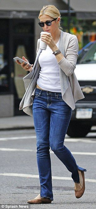 Caffeine fix: Kelly was pictured at another point on Tuesday sipping on a coffee with her iPhone in hand