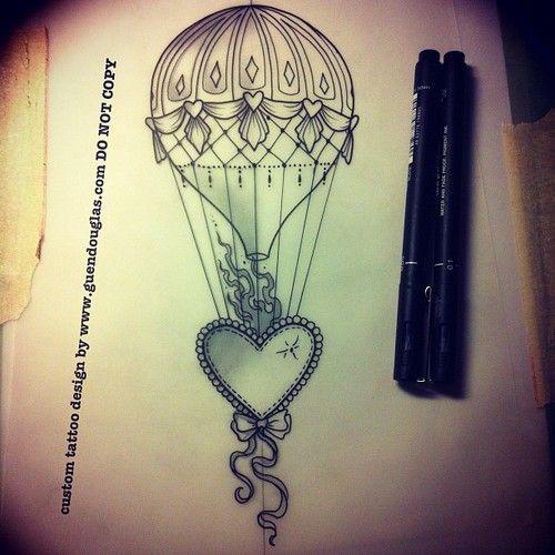 beaded heart and a hot air balloon tattoo