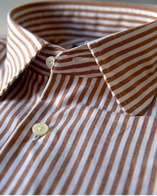 A great looking white/browwn-striped shirt. Stripes are great for incorporating colour in  a shirt.
