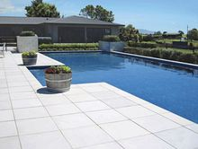 Main patio: MILANO 600 x 600  Pool edge: BULLNOSE 600 x 300  Both in natural stone colour