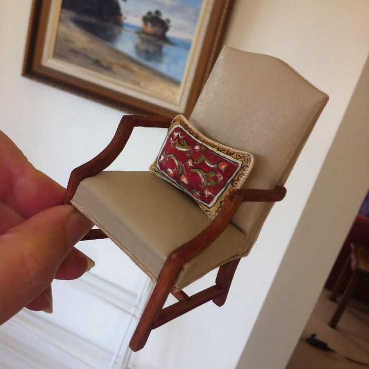 A cheap chair re-stained and re-upholstered and had painted cushion added.Pleased with the result.#dollhouse miniatures# miniature furniture.