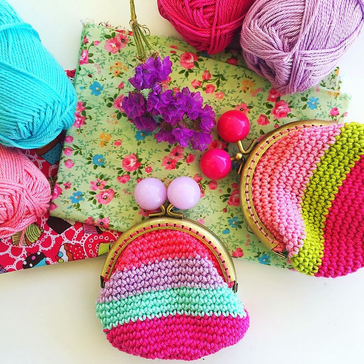 "I love bright colored yarn and vintage floral fabrics! I had quite some in my stash and ta dah! Crochet coin purses were born! The first two have been ""stolen"" by my Little Misses, so I've made some more and added them to the ship! Hope you like them!"
