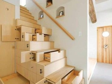 Clever sliding storage compartments under the stairs