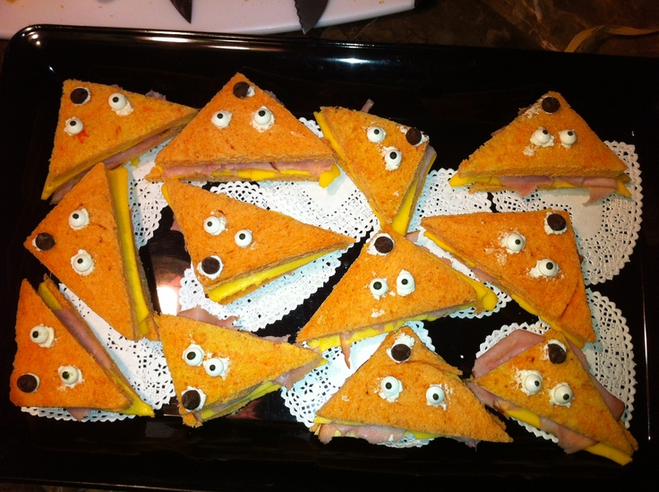 Planning a Gruffalo Party? Create some Roasted Fox (Ham and Cheese) Sandwiches made with Orange-Colored Bread, Candy Eyes and a Chocolate Chip Nose held in place with Cream Cheese!