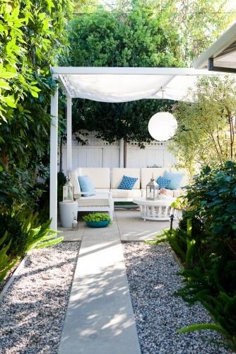 concrete patio + gravel bed + canopy.