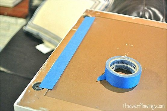 Place tape on the back of the frame marking where the holes are, then take the tape off, place tape on wall, level, where you want to hang the picture and put the nails where the marks are.