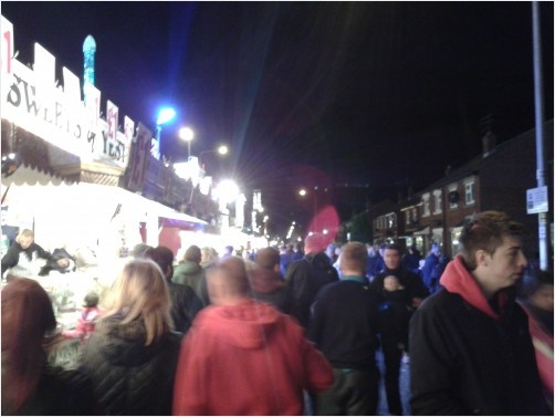 A view down Walton Street at Hull Fair 2012 of the food and concession stalls.