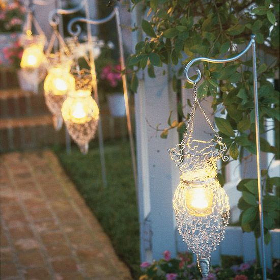 Outdoor lights, including floodlights, globes, tier lights, and lanterns, are easy to install and are the perfect way to add warmth and color to your front yard. For a touch of romance, use candle-lit lanterns to create soft pools of light along a garden path.
