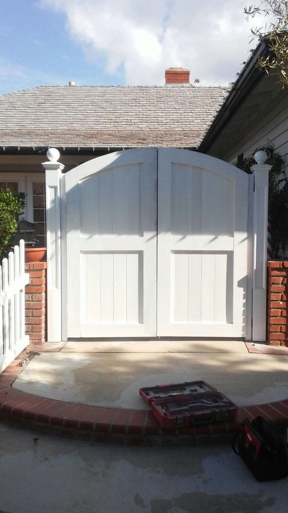 Photo of OC Local Garage Door & Gate - Costa Mesa, CA, United States. Supply and install 2 new custom wood gate in Newport Beach  by oc local garage door and gates