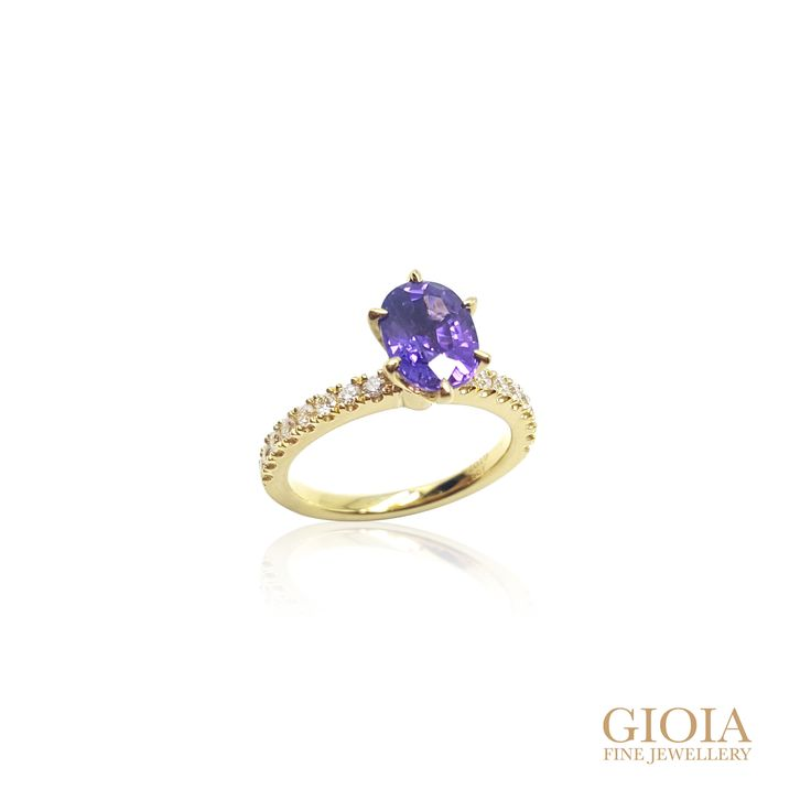 Purple Sapphire Proposal Ring Congratulation to Timothy and Samantha To this cute and wonderful couple: may you have a happy and blessed life ahead. We are so thrilled to hear your engagement! Congratulations and all the very best with the lovely life together. A ring with memories and loads of love A stunning proposal ring designed by both couple. Purple sapphire, custom set in yellow gold six prongs. With round brilliant diamonds, on the bands.